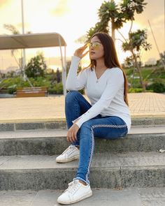 Image may contain: 1 person, sitting, shoes, sunglasses and outdoor Girl Photography Poses, Wedding Photography, Black Figure, Team 7, Hair Color For Black Hair, Bollywood Stars, Eye Color, Biography, Cute Couples