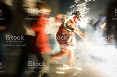 Girona, Catalonia, Spain – October 25, 2008: Participant of traditional Catalan festival 'correfoc' runs after a crowd with fireworks. The festival has its origins in 12th century.