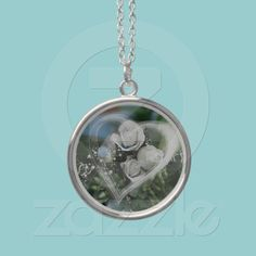 Love necklace  A lovely necklace pendant with a beautiful bunch of white roses a blue bird and a soft white heart. A nice bridal or wedding anniversary gift.