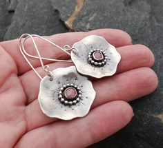 Each spring I look forward to the poppies that grow alongside my home -- they are one of the first plants to bloom. These earrings are
