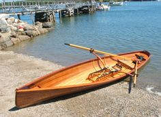 This is a strip plank sliding seat whitehall built by Salt Pond Rowing. It is a limited production 18 ft, 63 pound hull weight open water rower