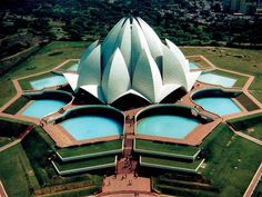 Lotus Temple, New Delhi, India. East of Nehru place, this temple is built in the shape of a lotus flower and is the last of seven Major Bahai's temples built around the world. Completed in 1986 it is set among the lush green landscaped gardens. Photo via expedition2india on Instegram #amitrips #travel #india #architecture
