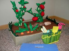Pool noodles and felt to make dramatic play garden