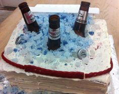 Ice chest cake with rock candy ice, cut beer bottles and twizzler handle.