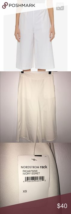White Gaucho Pants Never worn. Still has tags. XS high waisted white gaucho pants. The fabric is thin. Perfect for summer! It is best to wear no show nude or white underwear. free press Pants Wide Leg