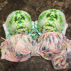 ❗️SALE❗️NWOT VS Bikini Bundle Both brand new, unworn without tag. Pink one still has attachable strap in package, the other one has the strap, but it isn't attached. Both size 36C. Pink one has single hook closure, other has two as shown in last picture. Victoria's Secret Swim Bikinis