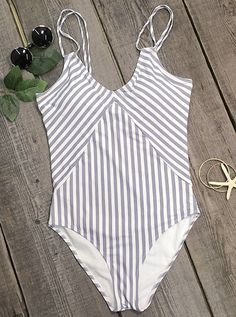 We think you've hit the mark with this one piece! Calm and cool stripes seem to set the mood and spirit of the season. Get you in with it.
