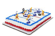 Easy soccer birthday cake uses Soccer Guys action figures Cake