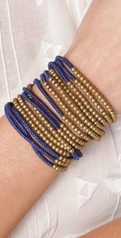 triple strand wrap bracelet with brass beads.