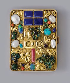LEFT: Josef Hoffmann (1870–1956), Tobacco case for Otto Primavesi, Vienna, 1912. Execution: Wiener Werkstatte. Gold; lapis lazuli, pearl, turquoise, coral, opal, cornelian, and other semiprecious stones. Private collection. Courtesy Neue Galerie New York.
