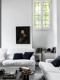 Gorgeous white room punctuated by a vintage oil painting.