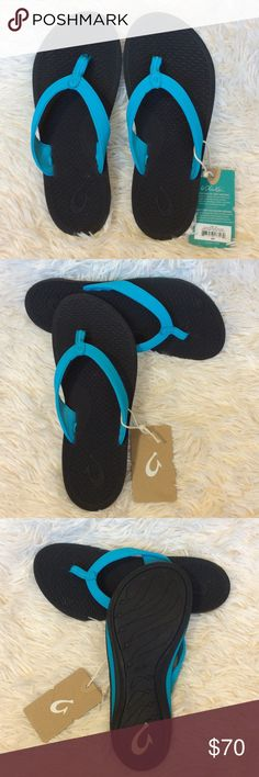 OluKai Ono Turquoise Flip Flop Thong Sandals OluKai Ono Thong Flip Flop Sandals in Coastal Blue and Black. Insole features a comfortable, textured pattern inspired by fish scales. This is a distinctly feminine thong sandal with an ocean look and feel. Thong toe, Makau (Maui big hook) symbol detail, contoured footbed with arch support, grip sole. Manmade upper and sole. Sizing: true to size, whole sizes only. for 1/2 sizes, order next size up. OluKai Shoes Sandals