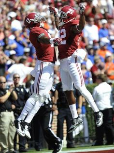 Alabama running back Kenyan Drake (17) celebrates with wide receiver Christion Jones (22) after Drake's touchdown in the first quarter at Bryant Denny Stadium in Tuscaloosa, Ala. on Saturday September 20, 2014.