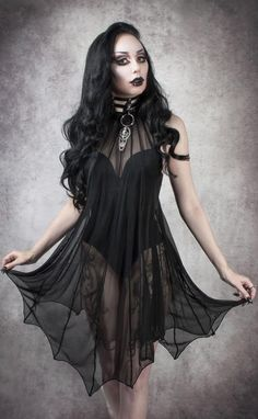 Necessary Evil Medeina Bat Wing Dress This gorgeous mesh dress from Necessary Evil features their signature bat wing stitching for the ultimate gothic evening look. The Medeina dress is a halter neck dress with a collar made from ultra lightweight. Goth Beauty, Dark Beauty, Dark Fashion, Gothic Fashion, Steampunk Fashion, Emo Fashion, Fashion Clothes, Batwing Dress, Goth Look
