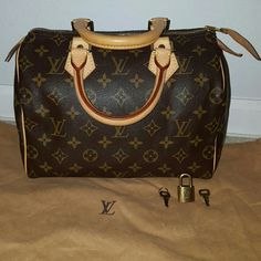 Louis Vuitton Speedy 100% authentic and in very good condition. Includes dust bag. Serial: SP1003 - Lock & Key no. 301 Louis Vuitton Bags