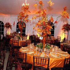 black and brown. giant fall leaf centerpieces. Fall Halloween wedding