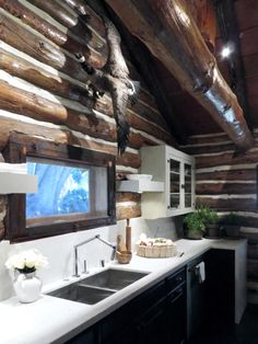 AMERICAN DREAM BUILDERS - CABIN - AFTER - DETAILS - Lukas's Kitchen: its all about keeping the authentic esthetics of the cabin with a modern twist, both work so well together. Clean lines with the white Sile Stone counter tops, black cabinets and floor. Finally clean line sink and a super modern faucet (KOHLER) those elements make this a cabin for modern living. www.LukasMachnik.com #DreamBuilders #AmericanDreamBuilders #TeamRED #Cabin #NBC #NateBerkus #LukasMachnik #SileStone #Lowes…