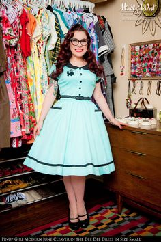The Dee Dee Dress in Mint and Black Pin Dots is a 50s-inspired silhouette and beyond adorable details; ladies around the world falling in love with Peter Pan collars all over again! Created for the Junebugs and Georgia Peaches Collection, this mint and black polka dots version features puffed and cuffed short sleeves, decorative fabric-covered buttons down the front, cute front pockets with black and white polka dot trim, and a matching band of dotted trim above the hem.