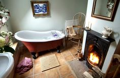 fireplace in your bathroom and claw foot tub...nothin more romatical than that