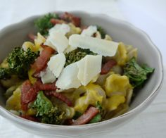 Creamy roasted garlic and butternut squash pasta with bacon, kale chips and parmesan cheese.