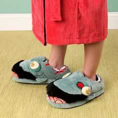 Zombie Plush Slippers - - Zombie Plush Slippers make you Look like you have conquered the deadliest zombie, and they are now serving you at your feet. Its one size fits almost all people.  It has soft material to give you comfort all time of the day.