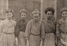 Faces of Lost Youth: Adolescent girls from Bibb Mfg. Co. in Macon, Georgia - Photograph by Lewis W. Hine  (Child Labor)