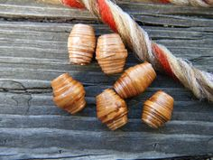 Six small wood beads made out of amber color birch bark with dark brown stripes, 9-11mm length, $12.00