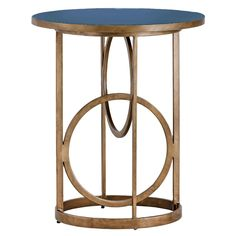 "Art Deco style gains dimension with the irresistibly chic Jackie side table from Gabby Furniture. A lustrous metal base boasts a scheme of interlocked rings, framed in straight lines to form a columnar silhouette. The disc-like top provides a sleek touch in blue painted resin. 26""W x 26""D x 31""H. Resin, metal. Navy blue seagrass, antique gold hammered metal finishes."