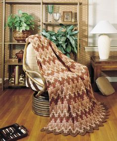 Afghan Parade eBook - What could possibly be more cozy than snuggling up with a warm afghan, next to the fireplace, on a cold winter night? In this book, you'll find four distinctively different crocheted designs that are great for snuggling. Each afghan is worked in one piece (no seams to sew!) using worsted weight yarn. We''ve included photographs of two different color combinations for each style, but your imagination is your only limitation. Designs include Small Shell by Leisure Arts…
