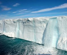 """Glacier waterfalls in Svalbard, Norway, found via The World Geography - """"Svalbard, which means """"cold coasts"""", is an archipelago in the Arctic, constituting the northernmost part of Norway as well as of Europe....The giant glacier Bråsvellbreen, located on Nordaustlandet the second largest island in the archipelago, stretches out for 200 kilometres (125 mi). The 15-20-metre (50-65 ft) high ice edge of this glacier is intersected by hundreds of melt-waterfalls."""""""