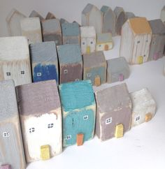 Houses with windows painted in Annie Sloan Chalk paint.  These come as a set of five but commissions welcome.