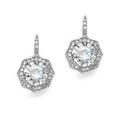 Brilliant 3 carat cubic zirconia surrounded by a glittering hexagonal pave design give these pierced lever back vintage drop earrings the look of fine jewelry. Bridal Accessories, Wedding Jewelry, Swarovski, Fashion Jewelry, Women Jewelry, Cubic Zirconia Earrings, Bridesmaid Jewelry Sets, Wedding Earrings, Sterling Silver Jewelry