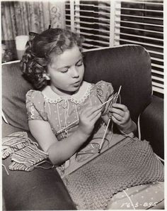 Shirley Temple knitting in her trailer on the set of Susannah of the Mounties, 1939