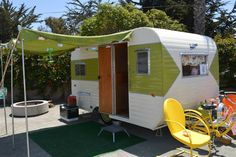 Vintage trailer with green stripe.