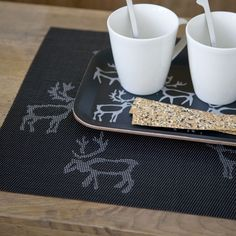 Pentik Saaga Placemat In Finland, reindeer aren't just meaningful during the holiday season. With the number of reindeer in Finland roughly equal to the number of people living there, it's become somewhat of a Lapland icon. Woodland Christmas, Placemat, Finland, Reindeer, Kitchen Dining, Kitchen Ideas, Number, Holiday Decor, Tableware