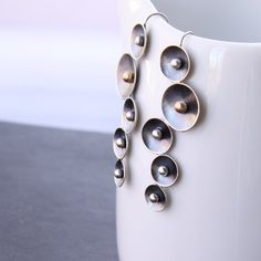 """Unique silver statement earrings forged of silver bowls with embedded 14K solid gold and argentium silver balls - """"Stellar Earrings"""". $160.00, via Etsy."""