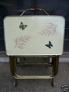 You are bidding on 4 Vintage TV Trays, and a cart that has 4 wheels and has a rolling tray that folds up to be used as a holder for the 4 vintage trays. The 4 trays appear to be made of fiberglass, a