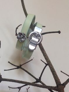 Pale green leather wrap bracelet with buckle and flower bead on Etsy, £14.00