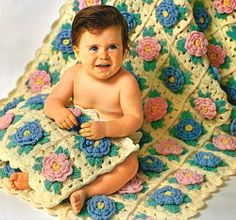 This intermediate crochet pattern features puffy flower crochet granny squares. These flowers make the baby blanket puffy and full of textur...