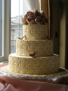 Yellow mosaic design, with small rolled-chocolate dark champagne and pink peonies. By Konditor Meister Elegant Wedding Cakes.