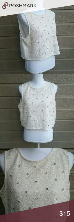 Lauren Conrad cream lace rhinestone crop top Lauren Conrad cream lace rhinestone crop top. There is a lining behind the lace layer, so the shirt is not see through and does not require a cami or tank top underneath. In good condition. Size LARGE. Bundle for a discount or make an offer! LC Lauren Conrad Tops Crop Tops