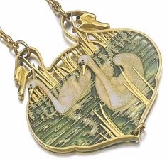 Lalique Pendant Deux Swans;  A pair of swans on a reed trimmed pond in gold and enamel, c. 1900