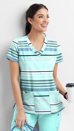 The UA Stripe Me Gulf Stream Rounded V-neck Print Scrub Top features comfortable rounded v-neck band, four front pockets for optimum storage, fitted back darts, and side vents for breathability. Stylish Scrubs, Scrubs Outfit, Uniform Advantage, Scrub Jackets, Medical Scrubs, Stylish Girl Images, Scrub Tops, New Print, Work Wardrobe