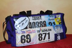 Mile 22 Bags Tri Duffel Bag. Custom made from race bibs and other running memorabilia. Running, marathon, half marathon, 10K, 5K, triathlon, Ironman. Carry your achievements with you!
