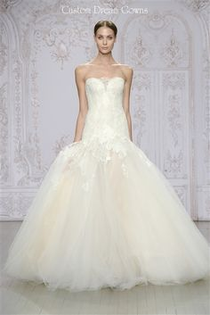 Anouk 2015 is a Romantic Chantilly Lace, Re-Embroidered Lace Applique, and Tulle…