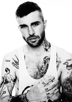 #tattoo  #inked  #badass  #shirtless  #sexy  #sleeves  #black  #birds  #pinup  #boy   #roses  #chestpiece #knuckles  #hot