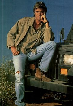 Mac in torn jeans with his jeep
