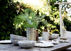 Summer entertaining at LUX / LODGE hollywood hills Aframe. Table filled with handmade LUX / EROS Ceramics in Snow white and gold with green leafy florals