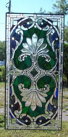 WOW ! largest selection of stained glass panels on the net. All so lovely.