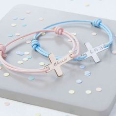 This engraved cross bracelet is a traditional christening or communion gift with a twist. The discreet cross symbol will lie flat upon the wrist with your engraving down the length. The large choice o. Personalised Christening Gifts, Christening Gifts For Boys, Christening Present, Baptism Gifts, Cadeau Communion, Communion Gifts, Cross Symbol, Bracelet Cordon, Plate